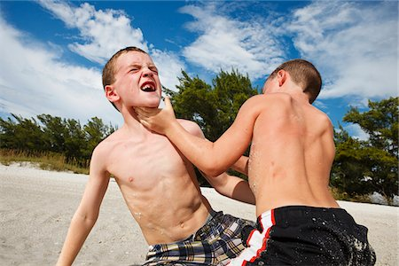 Brothers wrestling on the beach Stock Photo - Premium Royalty-Free, Code: 6106-05408990