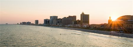 The sun sets over the Atlantic City boardwalk. Stock Photo - Premium Royalty-Free, Code: 6106-05409572