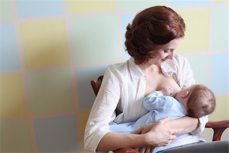 young mother breast feeding her baby boy Stock Photo - Premium Royalty-Free, Code: 6106-05410296
