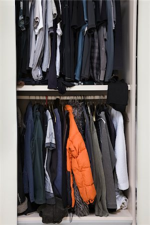View of an untidy male wardrobe Stock Photo - Premium Royalty-Free, Code: 6106-05410371