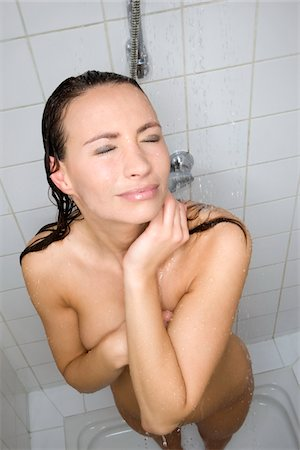 woman taking shower Stock Photo - Premium Royalty-Free, Code: 6106-05410317