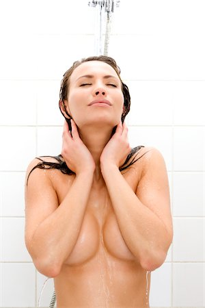 woman taking shower Stock Photo - Premium Royalty-Free, Code: 6106-05410315