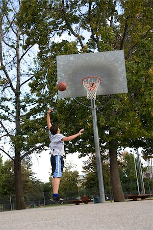 Hispanic teenage boy playing baseketball Stock Photo - Premium Royalty-Free, Code: 6106-05410464