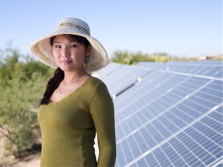 solar panel usa - Woman with Solar Panels Stock Photo - Premium Royalty-Free, Code: 6106-05410403
