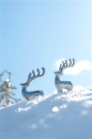 reindeer in snow - Reindeer shaped metal ornaments on snowy field Stock Photo - Premium Royalty-Free, Code: 6106-05410754