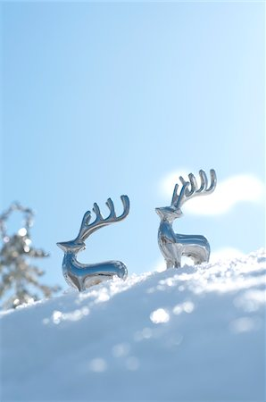 reindeer in snow - Reindeer shaped metal ornaments on snowy field Stock Photo - Premium Royalty-Free, Code: 6106-05410754