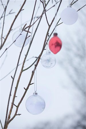 snow christmas tree white - baubles hanging on a Winter tree in the snow Stock Photo - Premium Royalty-Free, Code: 6106-05410718