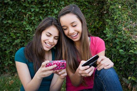 preteen girl - 12 year old girls texting Stock Photo - Premium Royalty-Free, Code: 6106-05410888
