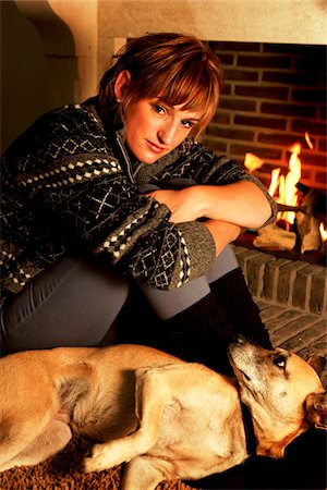 dog in heat - quiet moment at the fireplace Stock Photo - Premium Royalty-Free, Code: 6106-05410985