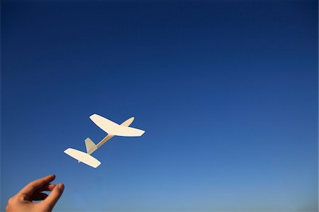 release - throw a paper airplane in the sky Stock Photo - Premium Royalty-Free, Code: 6106-05411265