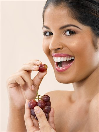 Woman Eating Grapes Stock Photo - Premium Royalty-Free, Code: 6106-05412050