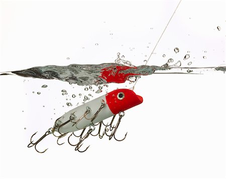 Fishing lure in water Stock Photo - Premium Royalty-Free, Code: 6106-05416056