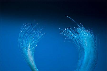 fiber optics nobody - standing optical fiber Stock Photo - Premium Royalty-Free, Code: 6106-05416536
