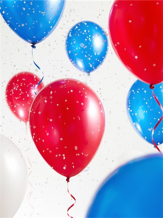 Red White and Blue Balloons with Confetti Stock Photo - Premium Royalty-Free, Code: 6106-05417860