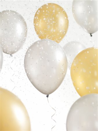 Gold and Silver Balloons with Confetti Stock Photo - Premium Royalty-Free, Code: 6106-05417866