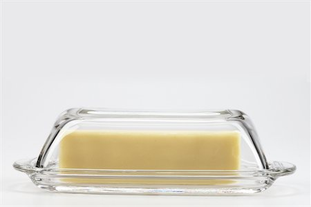 Butter in Glass Container Stock Photo - Premium Royalty-Free, Code: 6106-05421101