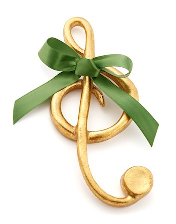 Gold Treble Clef Christmas Ornament with Green Bow Stock Photo - Premium Royalty-Free, Code: 6106-05421504
