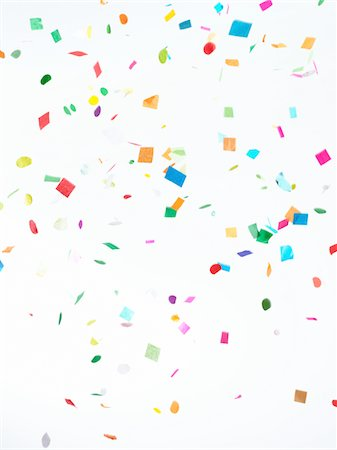 Multicolored Confetti on White Background Stock Photo - Premium Royalty-Free, Code: 6106-05421997