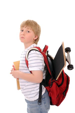 Elementary school student with skateboard Stock Photo - Premium Royalty-Free, Code: 6106-05423517