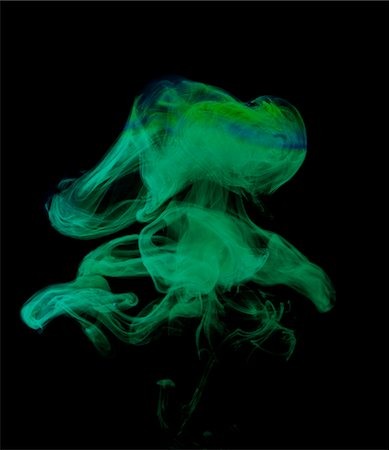 Green ink in water Stock Photo - Premium Royalty-Free, Code: 6106-05426433