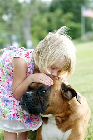 dog kissing girl - young irl kissing dog on head Stock Photo - Premium Royalty-Free, Code: 6106-05426938