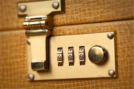 Golden Briefcase Lock Close Up Stock Photo - Premium Royalty-Free, Code: 6106-05427238