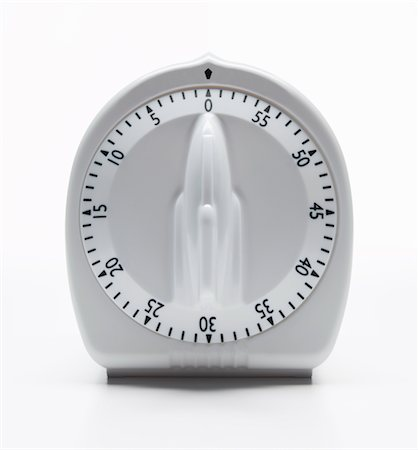 stop watch - Traditional kitchen timer Stock Photo - Premium Royalty-Free, Code: 6106-05429323