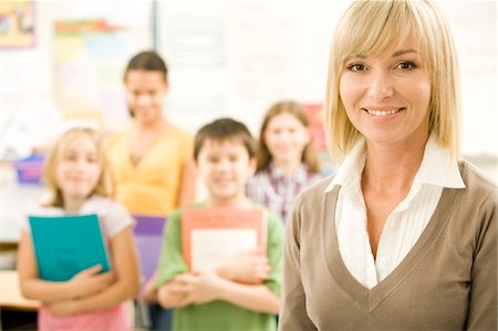 A Teacher Smiles With Her Students Stock Photo - Premium Royalty-Free, Code: 6106-05433041