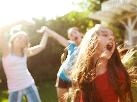 preteen dancing - three young girls singing and dancing Stock Photo - Premium Royalty-Free, Code: 6106-05434598