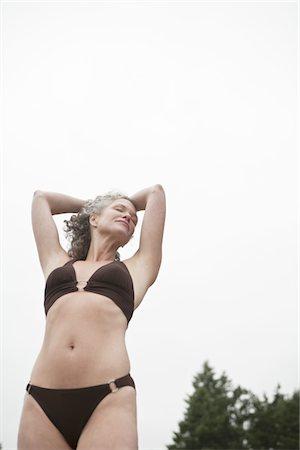Woman enjoying the summer at the water. Stock Photo - Premium Royalty-Free, Code: 6106-05438395