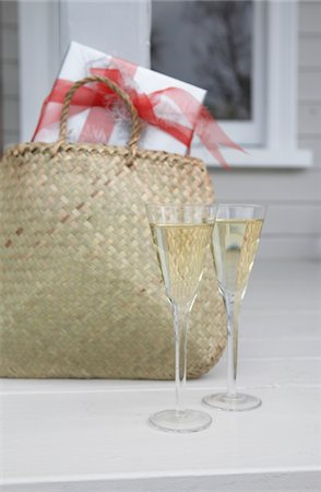 Glasses of Champagne and present Stock Photo - Premium Royalty-Free, Code: 6106-05439413