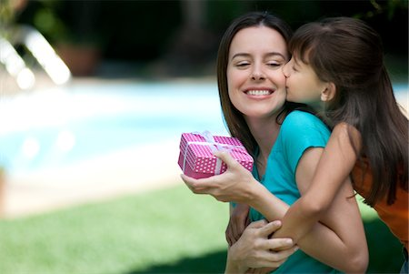 Mother receiving a gift from her daughter Stock Photo - Premium Royalty-Free, Code: 6106-05439794