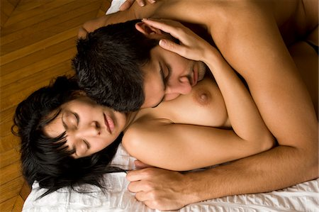 Couple making love on bed Stock Photo - Premium Royalty-Free, Code: 6106-05439889