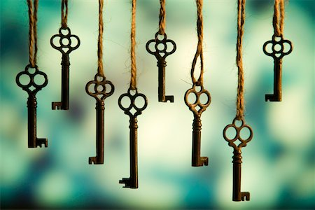 Antique keys on strings Stock Photo - Premium Royalty-Free, Code: 6106-05546753