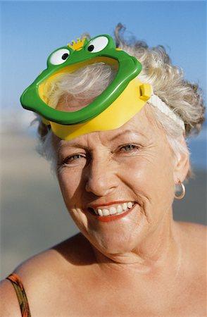 seniors woman in swimsuit - Portrait of a Senior Woman Wearing a Scuba Mask Stock Photo - Premium Royalty-Free, Code: 6106-05549102