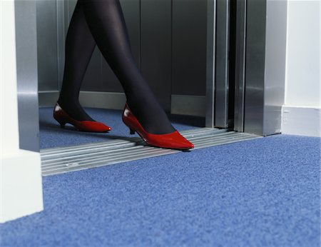 stocking feet - Young woman exiting lift, low section Stock Photo - Premium Royalty-Free, Code: 6106-05563908