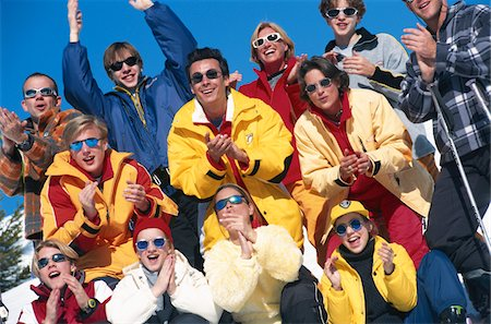 Group of people cheering from slopes, close up Stock Photo - Premium Royalty-Free, Code: 6106-05567277