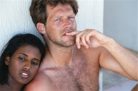 Couple sitting, close up Stock Photo - Premium Royalty-Free, Code: 6106-05568137