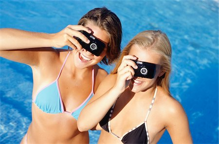 Two teenage girls (16-17) with two cameras taking picture Stock Photo - Premium Royalty-Free, Code: 6106-05572410