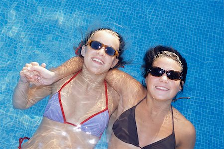 Two teenage girl (16-17) in pool, overhead view Stock Photo - Premium Royalty-Free, Code: 6106-05572415