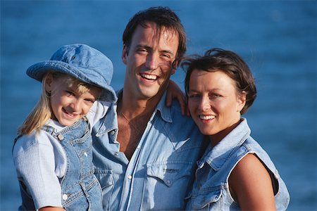 Parents with daughter, smiling, close up Stock Photo - Premium Royalty-Free, Code: 6106-05578052