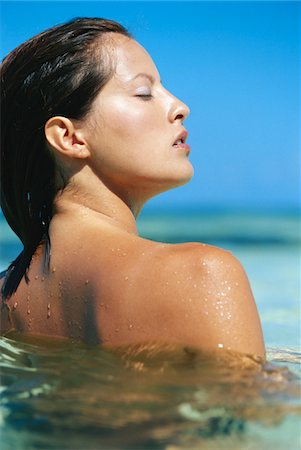 Woman in water at beach Stock Photo - Premium Royalty-Free, Code: 6106-05578415