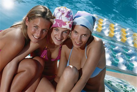 Teenage girls head to head near swimming pool Stock Photo - Premium Royalty-Free, Code: 6106-05582680