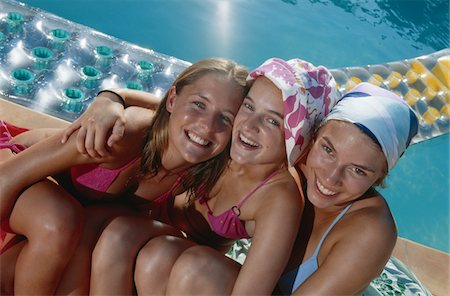 Teenage girls near swimming pool, laughing Stock Photo - Premium Royalty-Free, Code: 6106-05582681