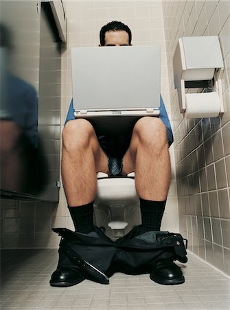 Half Dressed Businessman Using a Laptop Sitting in a Lavatory Stock Photo - Premium Royalty-Free, Code: 6106-05587628