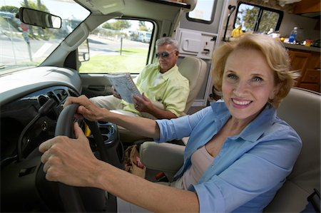 female truck driver - Senior Woman Sits in the Driver's Seat of a Motor Home, Her Husband Sitting by Her Looking at a Map Stock Photo - Premium Royalty-Free, Code: 6106-05589301