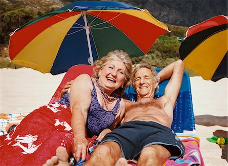 seniors woman in swimsuit - Senior Couple Lying on Sun loungers Stock Photo - Premium Royalty-Free, Code: 6106-05591759