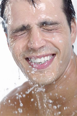 Smiling man Having a Shower Stock Photo - Premium Royalty-Free, Code: 6106-05591709