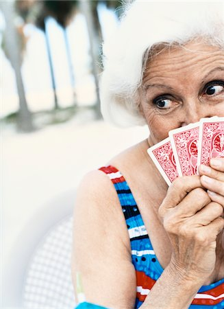 seniors woman in swimsuit - Woman Hiding Behind Her Playing Cards Stock Photo - Premium Royalty-Free, Code: 6106-05594278