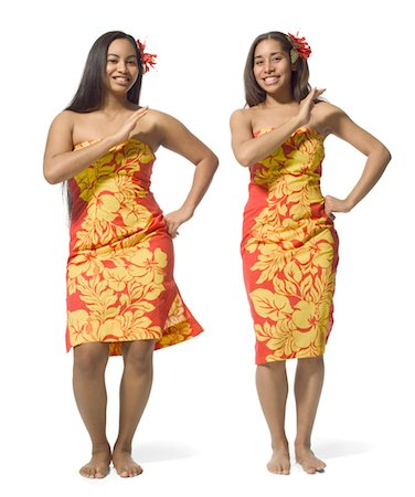 two polynesian teenage sisters in orange floral dresses do a traditional dance Stock Photo - Premium Royalty-Free, Code: 6106-05596460